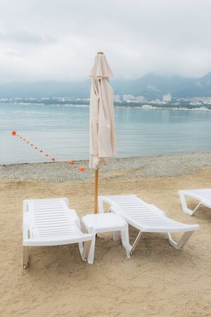 Photo of a deck chairs at the sunny beach. Stock Photo