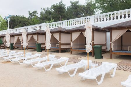 deck chairs and umbrellas on the beach.