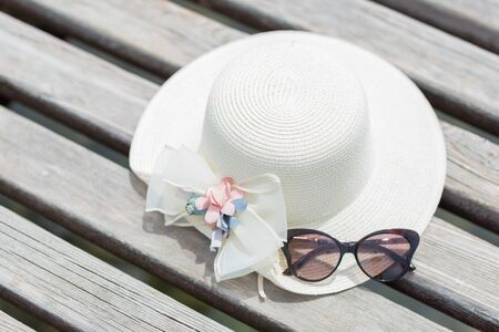 Eyeglasses and straw hat for summer holiday.