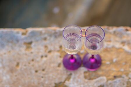 Champagne glasses with engagement Jewelry in front of aea background Stok Fotoğraf