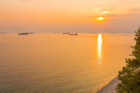 Bright sunset with small yellow sun under the sea surface Stok Fotoğraf