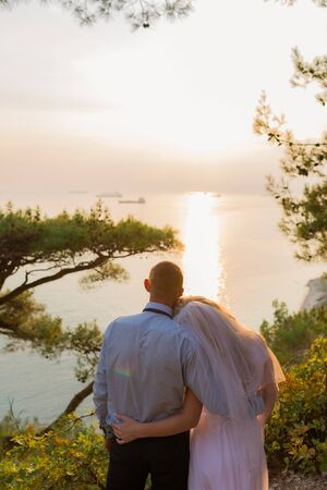 Couple looking at the sea in wedding clothing. Back view. Stok Fotoğraf