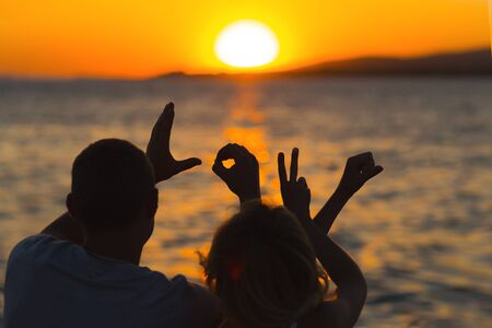The inscription I love you against the background of the sun setting over the ocean. Sunset and love. Wedding and Romantic. Stok Fotoğraf