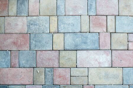 Stone pavement texture. Granite cobblestoned pavement background. Abstract background of old cobblestone pavement close-up. Stok Fotoğraf