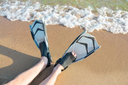Diving fins on the sand. Summer activities, sport concept. Stok Fotoğraf