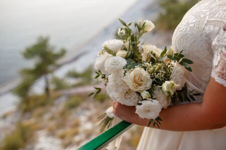 bouquet in the hands of the bride. Stok Fotoğraf
