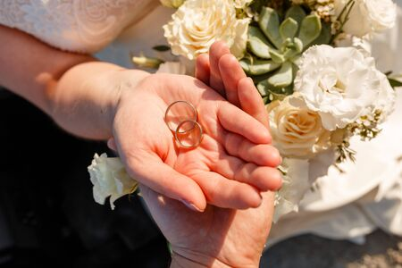 Giving of wedding ring on the wedding flower background. Stok Fotoğraf