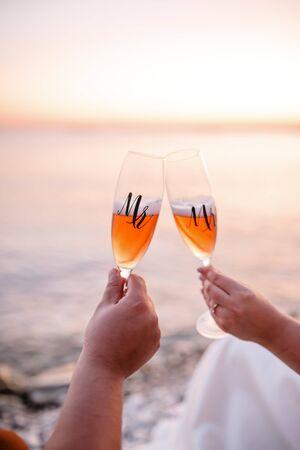 Romantic couple enjoying wine by the sea. Stok Fotoğraf