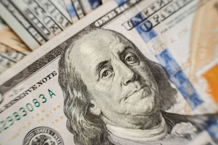 Macro close up of Ben Franklins face on the US one hundred dollar bill