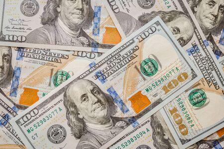 One hundred dollars pile as background. Stockfoto