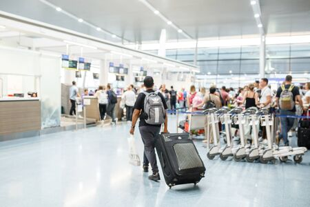People in airport terminal,blurred background. Stockfoto
