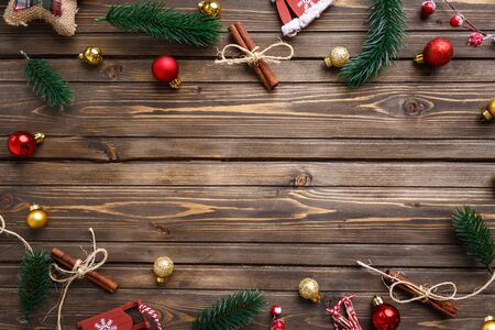 Christmas background with decorations on wooden board. Copy space.