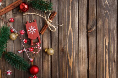 Brown wooden background with festive Christmas decoration, copy space. Stock Photo