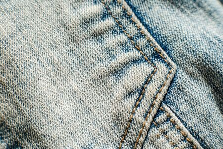 Jeans background, denim with seam of fashion design.