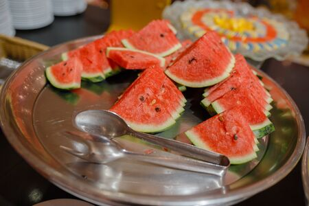 watermelon on a wooden table , beautiful buffet style.