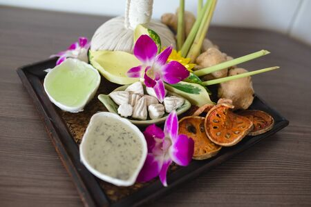 Beautiful composition of spa treatment on wooden table.
