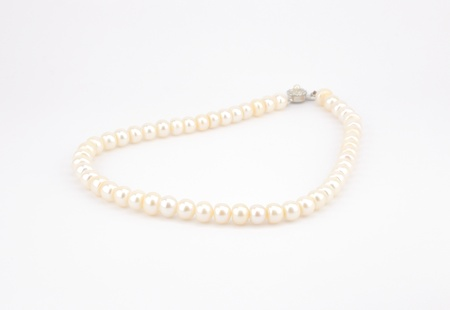 prosper: white pearl necklace isolate on white background