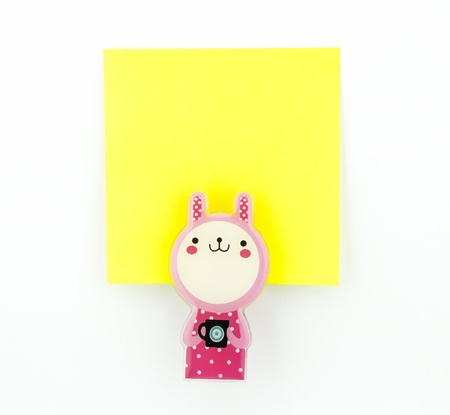 post-it, yellow note pad with pink rabbit clip Stock Photo - 20382362