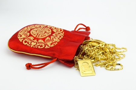 priced: golden happy buddha and ornament gold with red bag isolate on white background