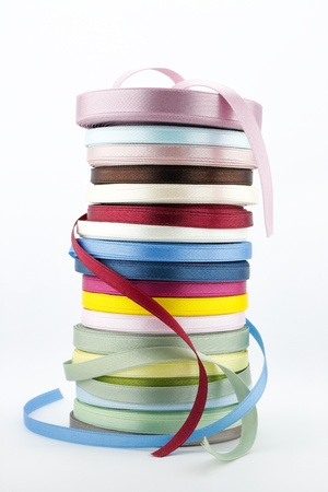 colorful ribbons, art and craft supplies on white background Imagens