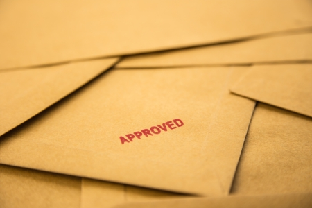 red approved sign on envelope, recruitment and human resources