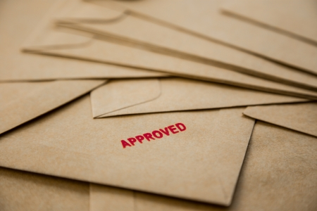 approved sign: red approved sign on envelope, recruitment and human resources