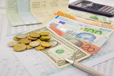 economize: currency and paper money of world, saving account and money concept Stock Photo