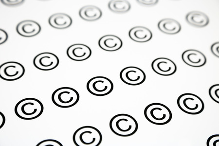 copyrighted: pattern of copyrighted sign, black and white background