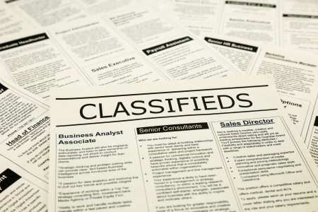 classifieds: newspaper with advertisements and classifieds ads for vacancy, search for jobs
