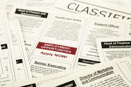newspaper with advertisements and classifieds ads for vacancy, employment opportunities
