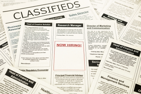 newspaper with advertisements and classifieds ads for vacancy, now hiring photo