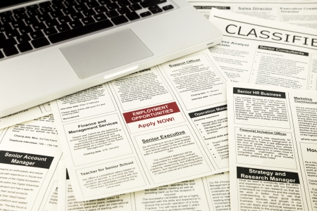classifieds: newspaper with advertisements and classifieds ads for vacancy, job search and apply now