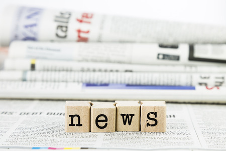 news concept, close-up wooden text wording on newspaper Banque d'images
