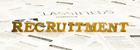classifieds: closeup recruitment wording on classifieds ads and newspaper, human resource and employment concepts and ideas