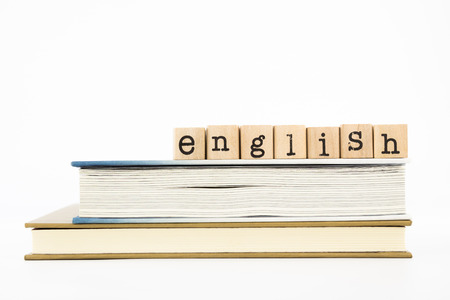 closeup english wording stack on books. english for foreigner, tutorial and learning concept and idea. Banque d'images