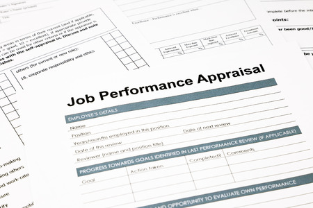 review: closeup job performance appraisal and paperwork, evaluation and assessment concept for human resource business