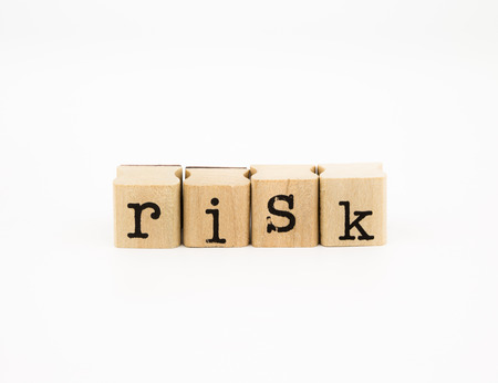 wording: closeup risk wording isolate on white background, investment and insurance concept and idea  Stock Photo
