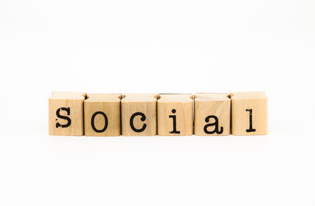 socialization: closeup social wording isolate on white background, community and socialization concept and idea