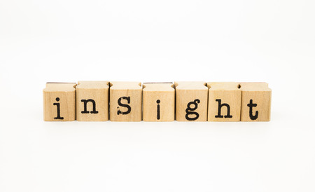 closeup insight wording isolate on white background, intelligence and knowledge concept and idea