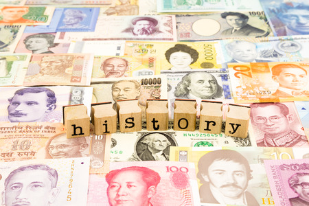 closeup history wording stack on banknotes, world currency, business and education concept and idea