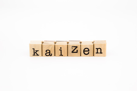 closeup kaizen wording isolate on white background, business and productivity concept and idea