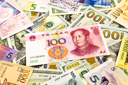 deflation: chinese and world currency money banknote, business and  financial concept Stock Photo