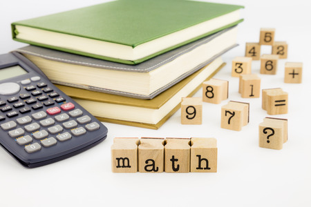 closeup math wording and books, mathematics, education and business concept