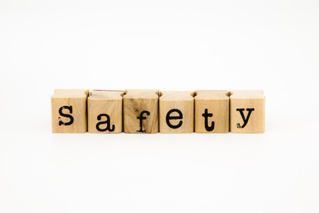 inoffensive: closeup safety wording isolate on white background