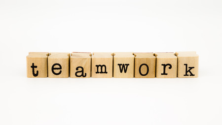 closeup teamwork wording isolate on white background