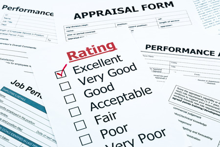 closeup red excellent check mark on rating form, evaluation and assessment concept for human resource and business