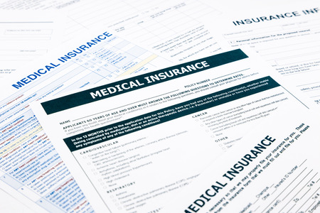 recompense: medical insurance form, paperwork and questionnaire for insurance concepts Stock Photo