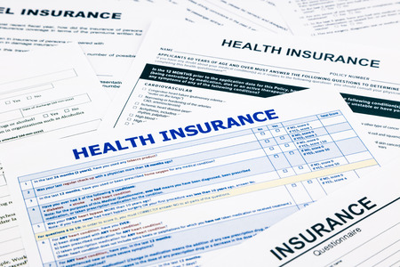 recompense: health insurance form, paperwork and questionnaire for insurance concepts