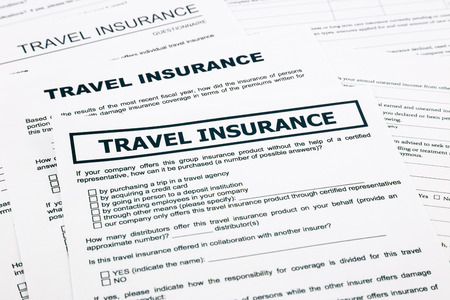 recompense: travel insurance form, paperwork and questionnaire for insurance concepts