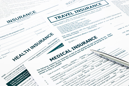 medical insurance: medical insurance form, paperwork and questionnaire for insurance concepts Stock Photo